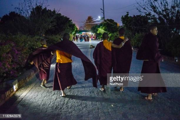 A group of young Buddhist monks walk through the Monastic Zone area Lumbini Nepal on March 19 2019 Lumbini is one of the worlds most Buddhist...