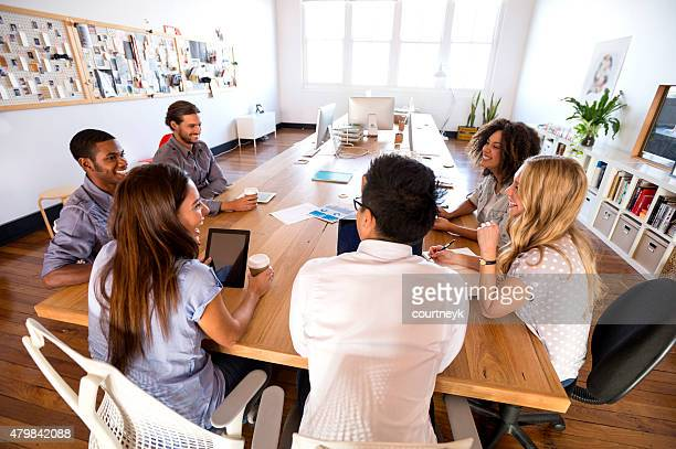 Group of young business people in a meeting.