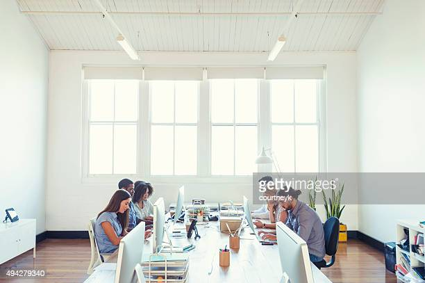 group of young business people working. - wide angle stock pictures, royalty-free photos & images