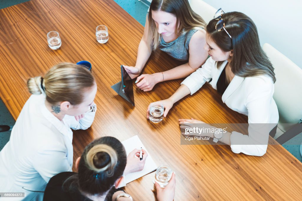 Group of young businesswoman having a meeting : Stock Photo