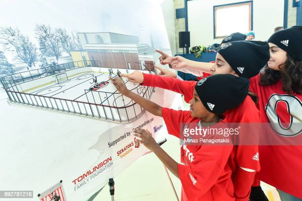 A group of young children point to the rendering of the new rink during the 2017 Scotiabank NHL100 Classic Legacy Project press conference at the...