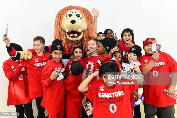 A group of young children pose with the Ottawa Senators mascot Spartacat during the 2017 Scotiabank NHL100 Classic Legacy Project press conference at...