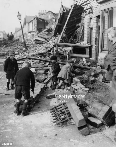 Group of young children starting to rebuild their homes after German raiders devastated their coastal town.