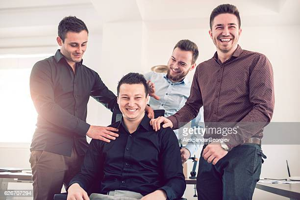 group of young coworkers making fun of colleague in office - massage funny stock pictures, royalty-free photos & images