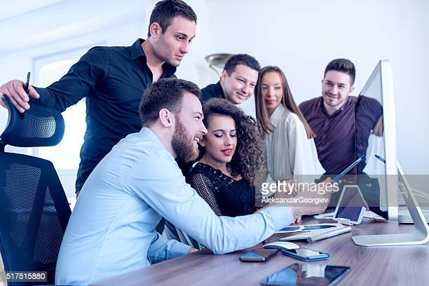 Group of Young Coworkers Working on Project in Modern Office