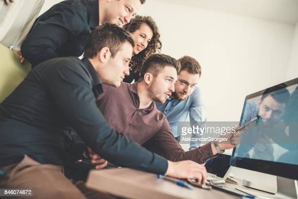 group of young coworkers working on project in modern office - aleksandar georgiev stock photos and pictures