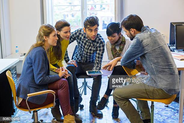 Group of young creative people at a startup meeting
