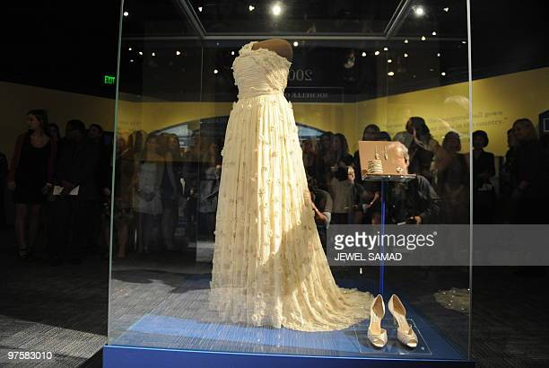 A group of young designers from Huntington High School Fashion Program from New York look at a display of US First Lady Michelle Obama's inaugural...