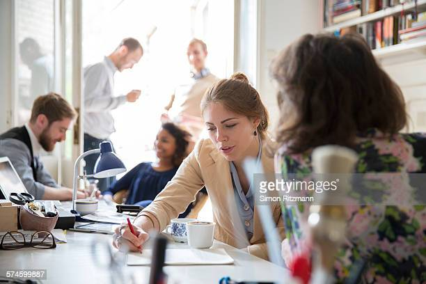 group of young designers working together. - medium group of people stock pictures, royalty-free photos & images