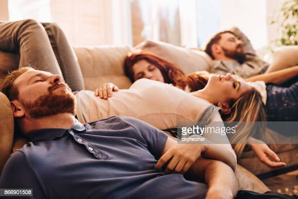 group of young drunk people sleeping in the living room. - hangover after party stock pictures, royalty-free photos & images