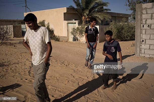 A group of young Egyptian bedouins walk through the village of Al Muqattah in Egypt's restive North Sinai region September 20 2012 The village of Al...