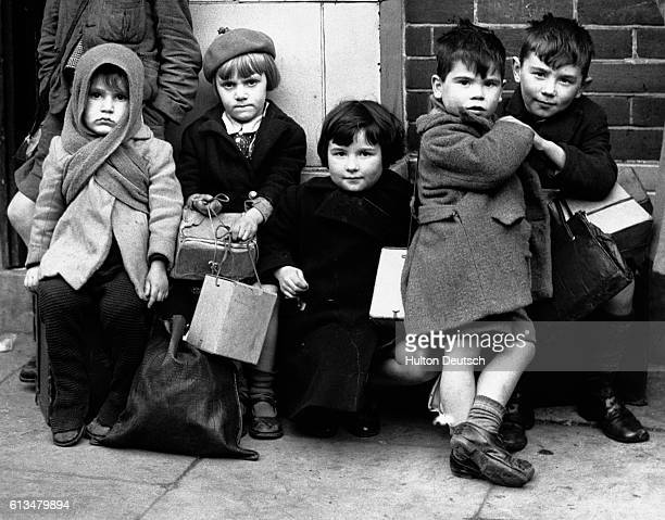 A group of young evacuees awaits transport out of Southampton England after their homes are damaged by World War II raids
