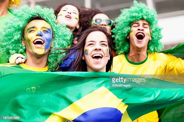 A group of young fans cheering for Brazil at football match