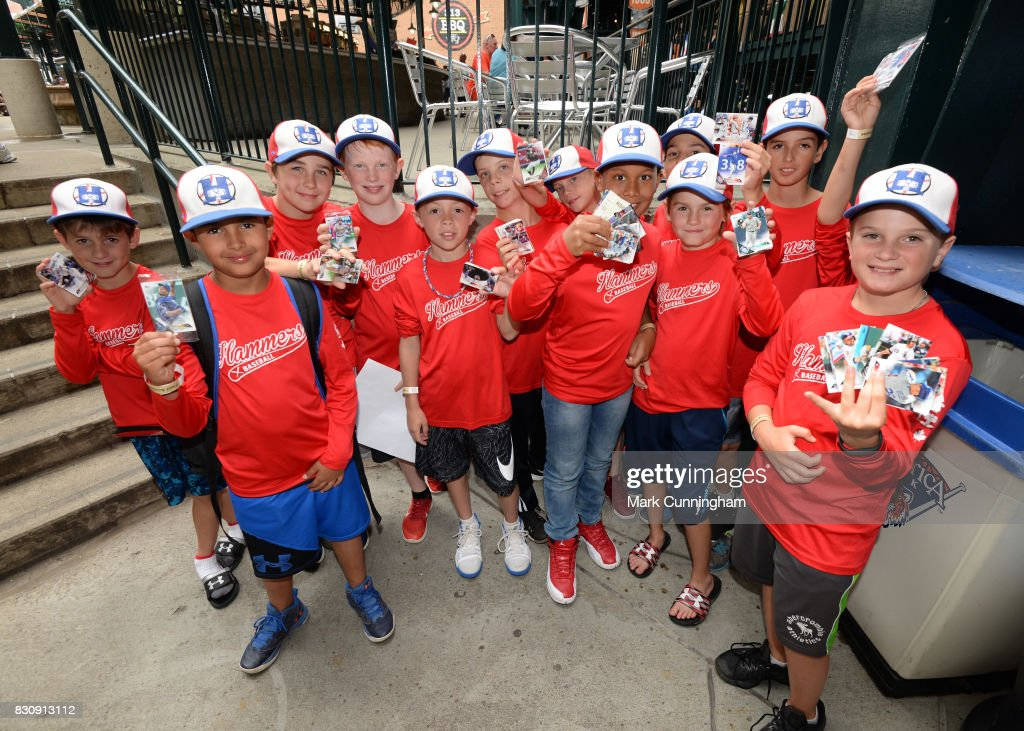 A group of young fans hold up their Topps baseball cards which were given out to fans to celebrate National Baseball Card Day prior to the game between the Detroit Tigers and the Minnesota Twins at Comerica Park on August 12, 2017 in Detroit, Michigan. The Tigers defeated the Twins 12-11.
