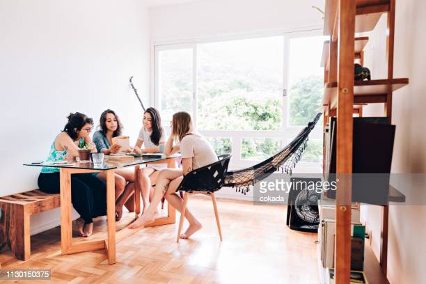 group of young female students studying at home - roommate stock pictures, royalty-free photos & images
