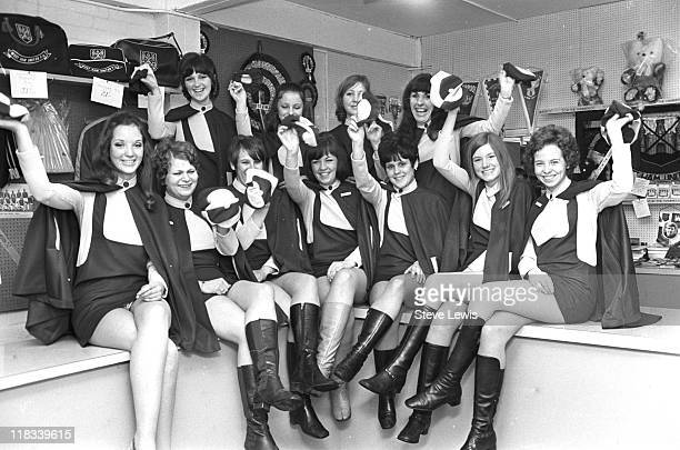 A group of young female supporters surrounded by West Ham United merchandise circa 1970