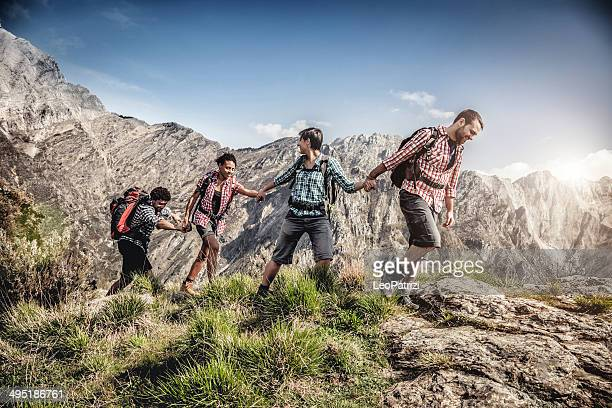 Group of  young friend hiking in mountain