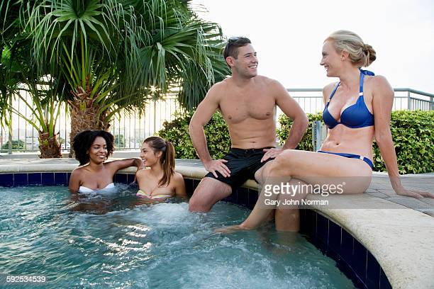 Group of young friends in outdoor spa