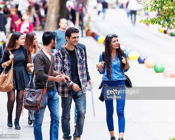 group of young friends on bahariye street istanbul - kadikoy stock photos and pictures