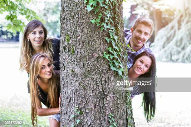 Group of young friends playing hide and seek outdoor