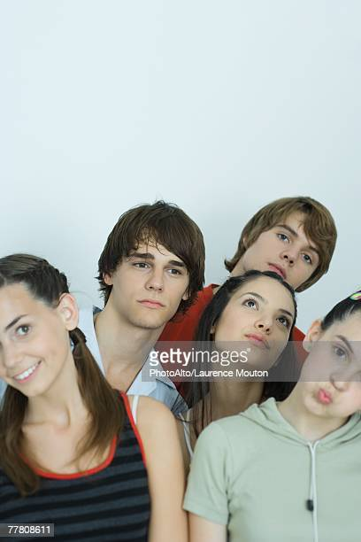 Group of young friends posing for photo, heads tilted, portrait