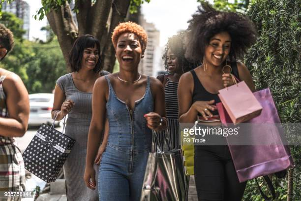 group of young friends shopping in street - bronx stock pictures, royalty-free photos & images