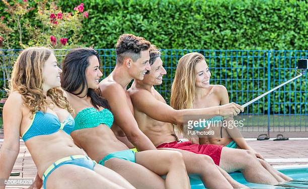 group of young friends taking selfie at poolside - pjphoto69 stock pictures, royalty-free photos & images