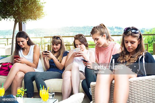Group Of Young Friends Vasting Time On Their Phones