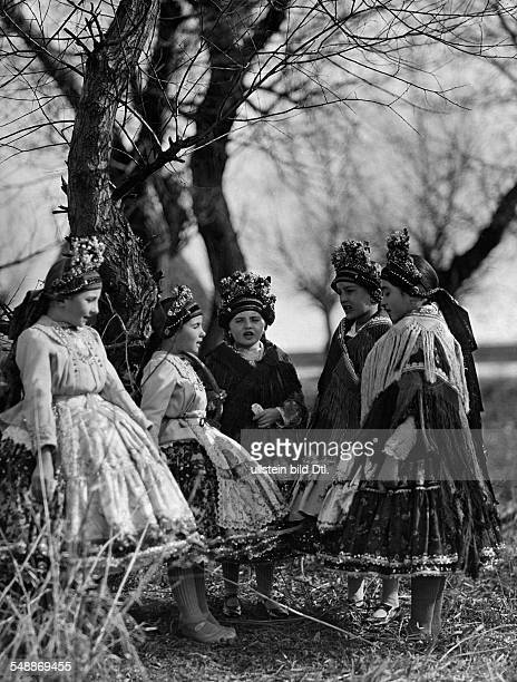 Group of young girls dressed in traditional costumes 'praising the spring' - ca. 1935 - Photographer: Rudolf Balogh - Published by: 'Der Bazar'...