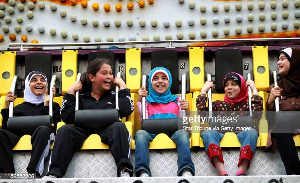 Group of young girls enjoyed the rides on Warren Avenue June 17, at the 17 annual Arab American Festival in Dearborn, MI. Dearborn.] JERRY HOLT/ STAR...