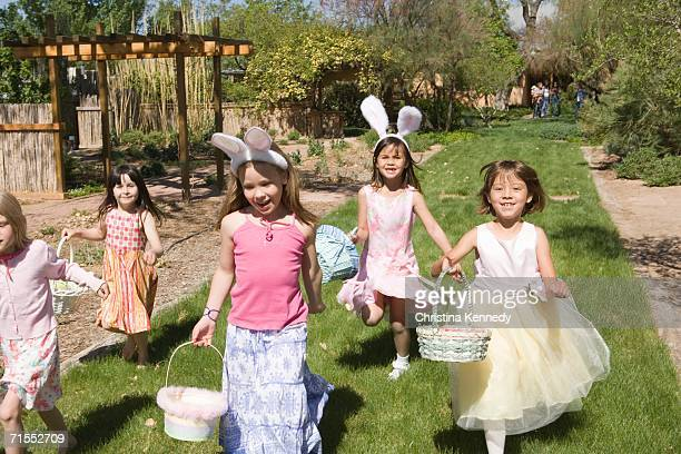 Group of young girls on Easter egg hunt
