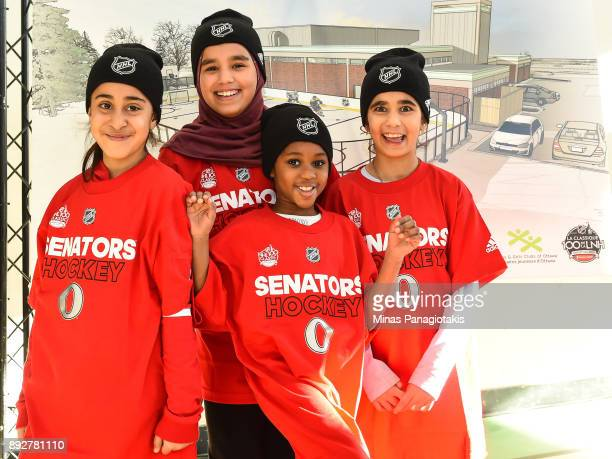 A group of young girls pose for a photo by the rendering of the new outdoor rink during the 2017 Scotiabank NHL100 Classic Legacy Project press...