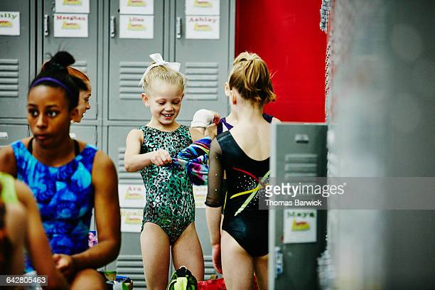 Group of young gymnasts looking at leotard options