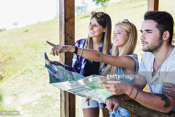 Group of young hikers with a map