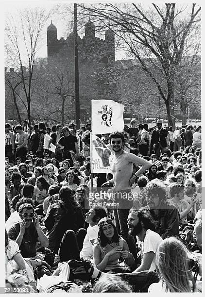 A group of young 'hippie' protestors demonstrate on the New Haven Green across the street from Yale University's Phelps Hall at a rally in favor of...