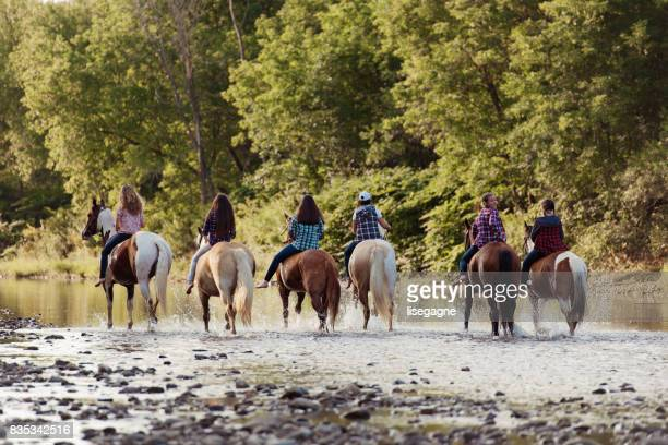 group of young horse riders exercising in a paddock - british columbia stock pictures, royalty-free photos & images