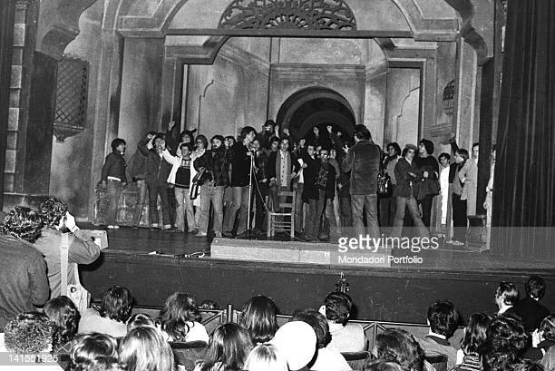 A group of young Italians demonstrating on the Teatro Lirico stage They are part of the proletarian circles in favour of autoriduzione Milan 1976