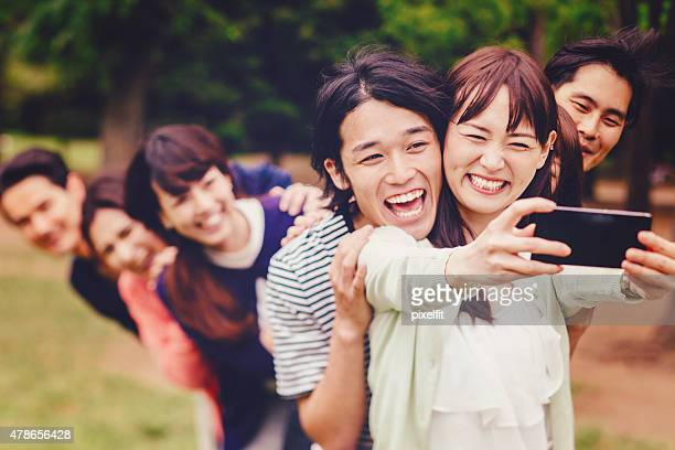 Group of young japanese people making selfie