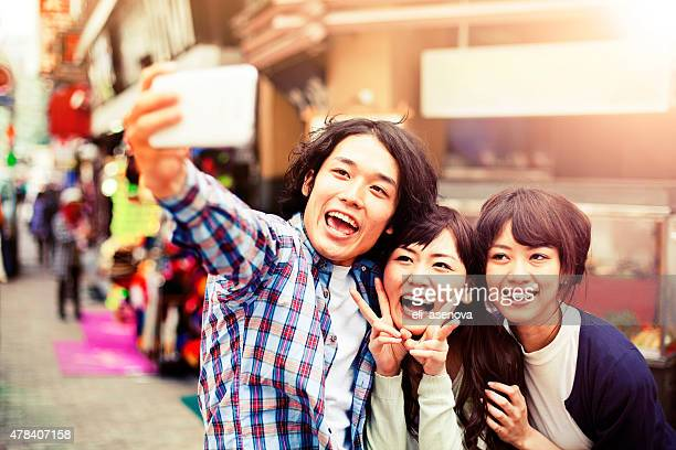 Group of young japanese people making selfie, Tokyo,