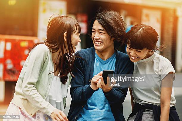 group of young japanese people with smart phone - east asian culture stock photos and pictures