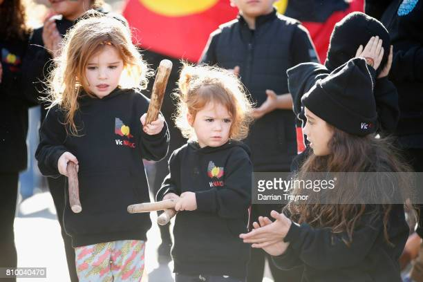 A group of young kids take part in the 2017 NAIDOC March on July 7 2017 in Melbourne Australia The march was organised to call for a day of mourning...