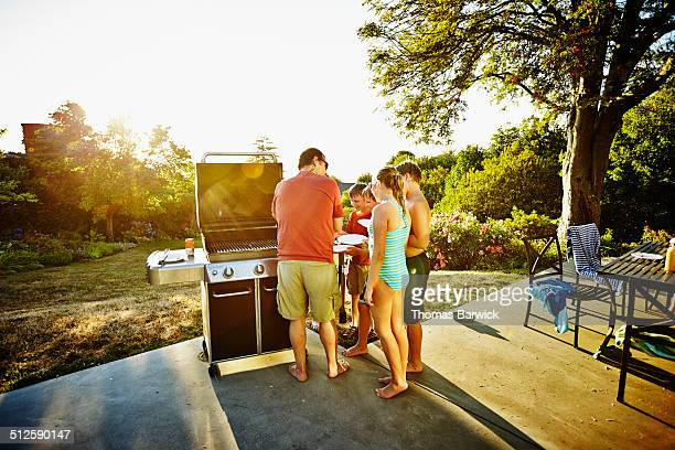 Group of young kids waiting for food at barbecue