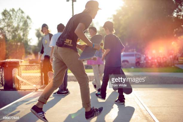 Group of young male skateboarders at skatepark