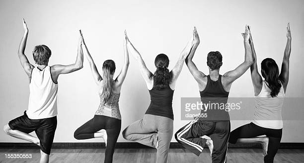 Group Of Young men and Women In Yoga Class