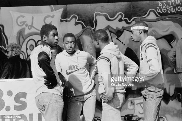 Group of young men by the DJ booth at the 'Hip Hop Jam', a free festival held by the GLC on the South Bank, London, 9th September 1984.