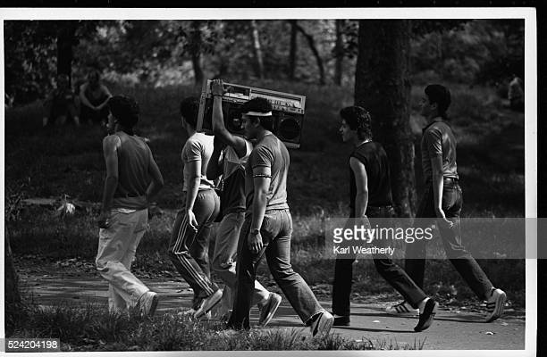 A group of young men carries a portable stereo through Central Park in Manhattan
