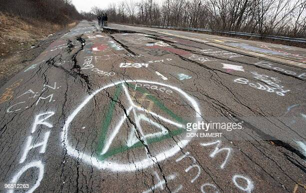 A group of young men from Philadelphia explore a large crack in PA Highway 61 caused by the underground coal fire February 2 2010 in Centralia PA The...