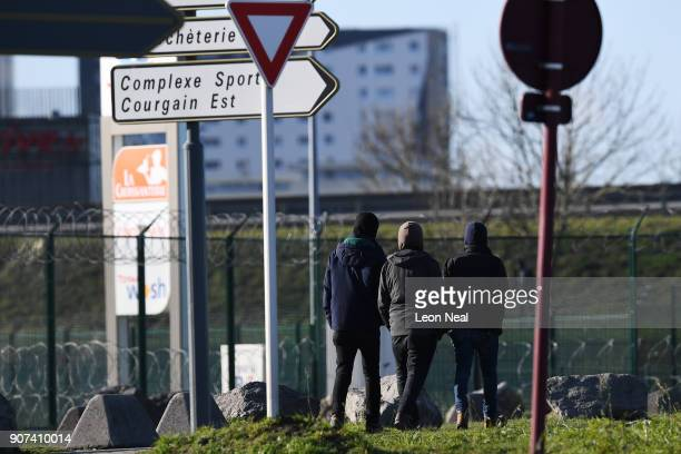 A group of young men gather near a truck depot on January 19 2018 in Calais France During a visit to the UK by French President Emmanual Macron the...