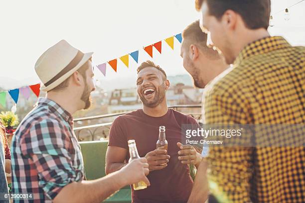 Group of young men on a rooftop party