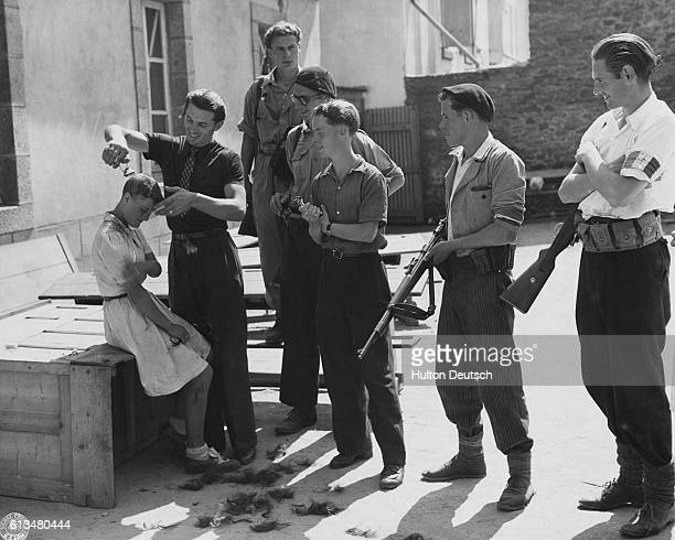 A group of young men shave the head of a young woman accused of collaborating with the Nazi occupiers of France This will mark her so all will know...